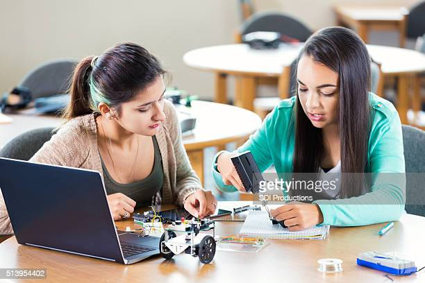 High school friends working on robotics assignment