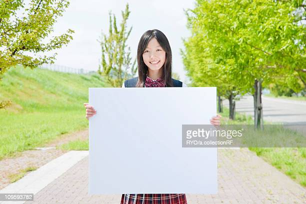 High School Girl Holding Blank Message