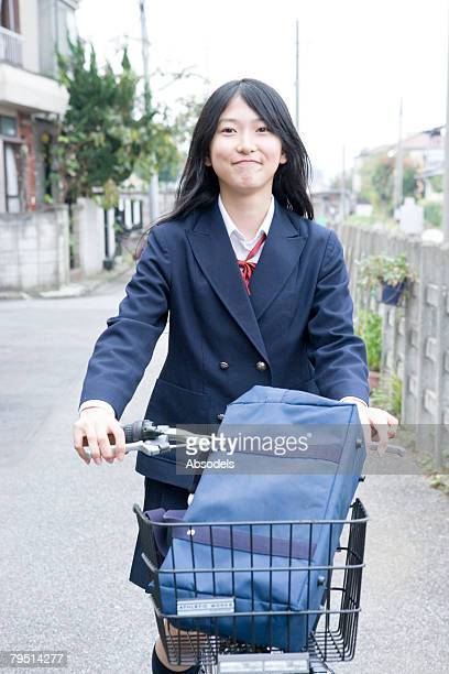 High school girl riding bicycle