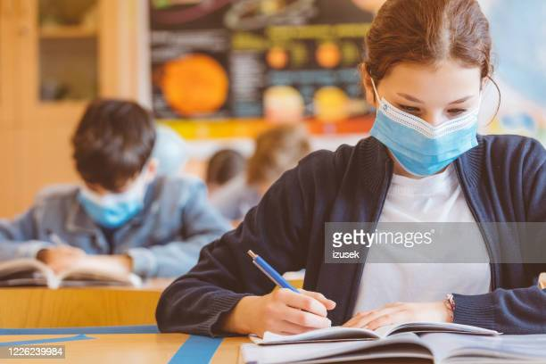 high school girl student at school wearing n95 face masks - school building stock pictures, royalty-free photos & images