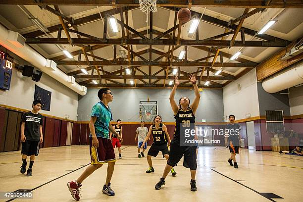 High school girls play against middle school boys in a game of basketball on June 29 2015 in Newtok Alaska Newtok which has a population of...