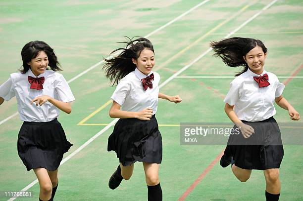 High School Girls Running on the Schoolyard