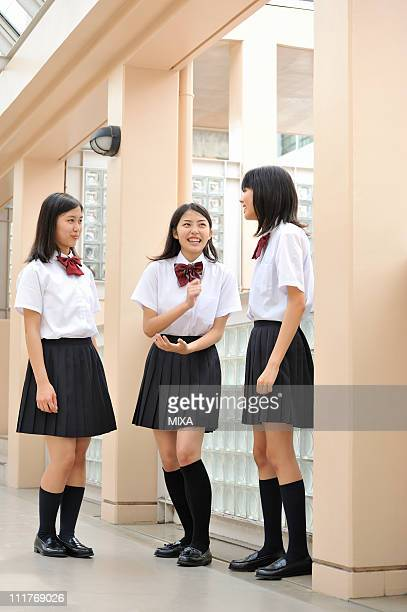 high school girls talking at hallway - female high school student stock pictures, royalty-free photos & images