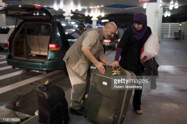 High school graduate Asmaa Rimawi is helped by her father at JFK Airport August 26 2010 in Queens New York to catch a flight to Boston Massachusetts...