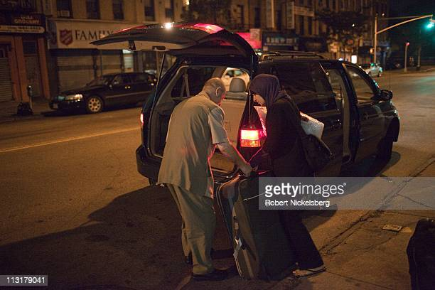 High school graduate Asmaa Rimawi, right, is helped by her father as she leaves her home August 26, 2010 in Bay Ridge, New York for the airport to...