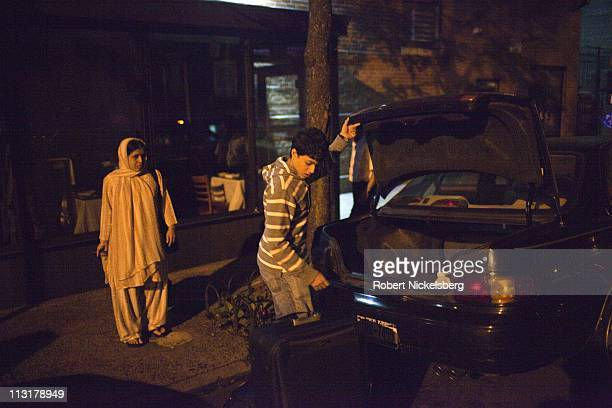 High school graduate Mohamed Amin loads his suitcases before leaving for the airport August 28 2010 in Jackson Heights New York to take a flight to...