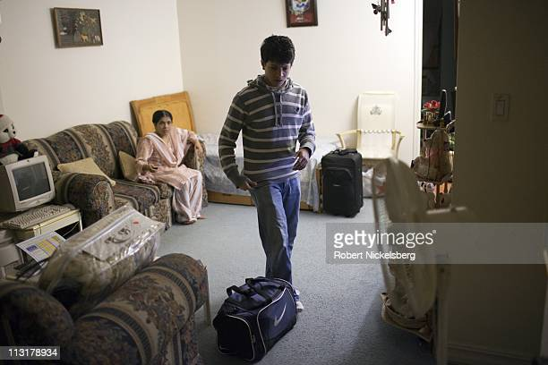 High school graduate Mohamed Amin speaks with his mother before he leaves his home August 28, 2010 in Jackson Heights, New York for the airport to...
