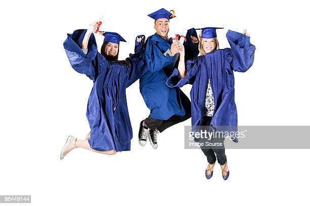High school graduates jumping