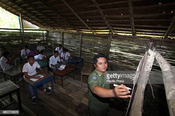 High school in the district bordering the Philippines, the building is made of bamboo, thatch roof of woven leaves, and the floor is still on the...