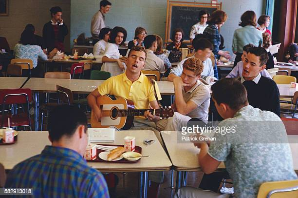 High School Kid Playing a Guitar and Singing