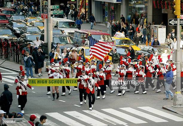 A high school marching band walks through the streets to kick off TRL High School Week on MTV at the MTV Times Square Studios April 14 2003 in New...