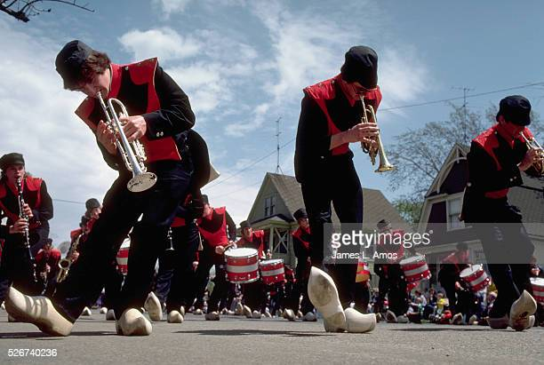 A high school marching band wears wooden shoes in a tulip festival Holland Michigan