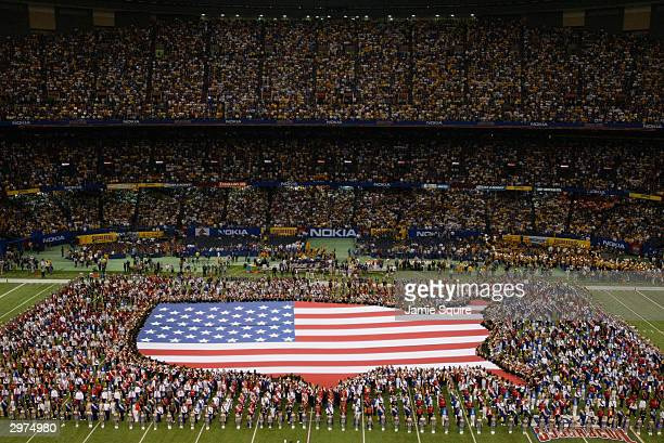 18 high school marching bands perform during half time of the National Championship Nokia Sugar Bowl between the University of Oklahoma Sooners and...