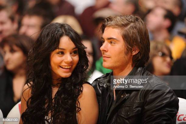 High School Musical stars Zac Efron and Vanessa Hudgens watch the game from courtside between the New York Knicks and the Los Angeles Lakers at...