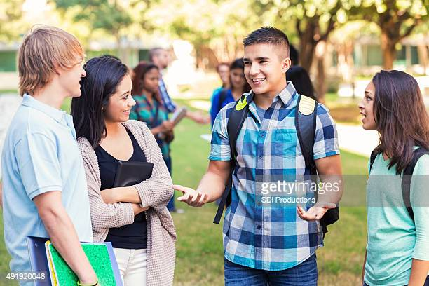 High school or college friends talking after class outdoors