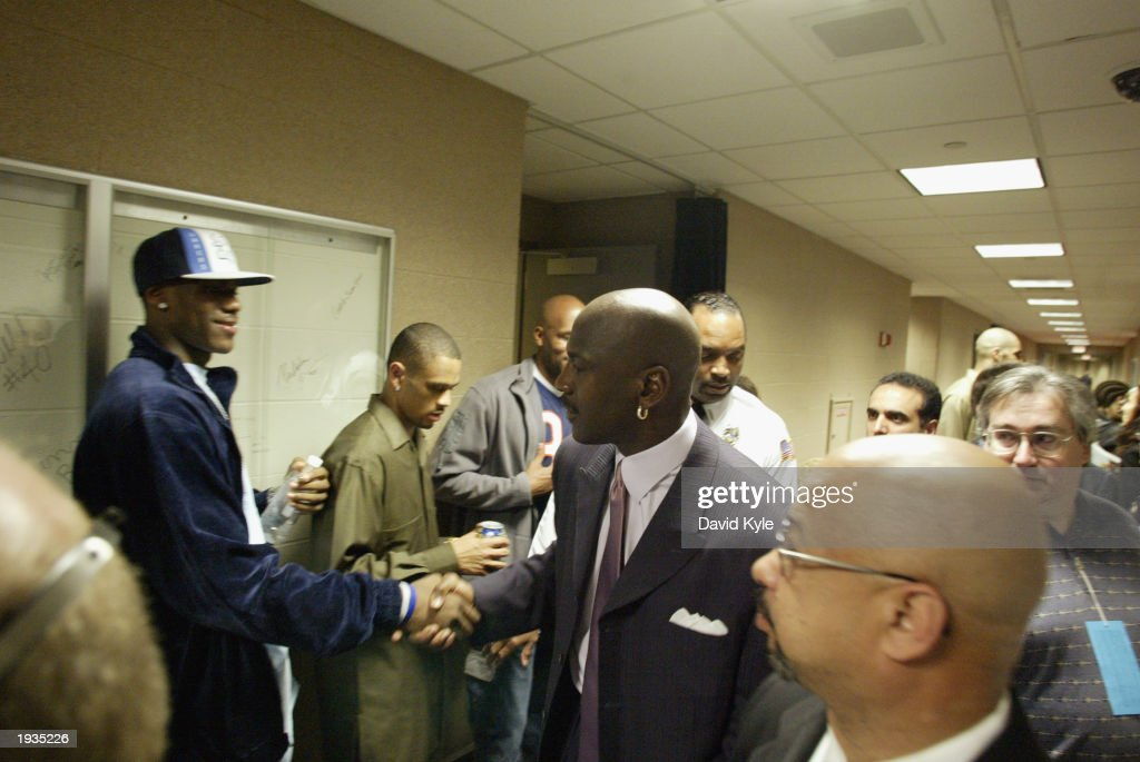 High school phenomenon LeBron James #23 of the St. Vincent-St. Mary Fighting Irish shakes hands with Michael Jordan #23 of the Washington Wizards after Jordan's game against the Cleveland Cavaliers at Gund Arena on April 8, 2003 in Cleveland, Ohio. The Wizards won 100-91.