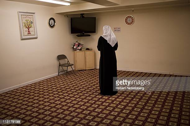 High school senior Asmaa Rimawi 17 years prays at the Islamic Center of Bay Ridge Mosque June 12 2010 in Brooklyn New York Asmaa will graduate from...