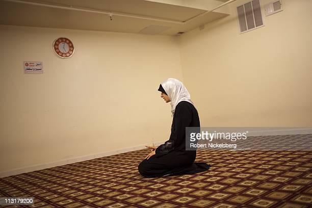 High school senior Asmaa Rimawi, 17 years, prays at the Islamic Center of Bay Ridge Mosque June 12, 2010 in Brooklyn, New York. Asmaa will graduate...