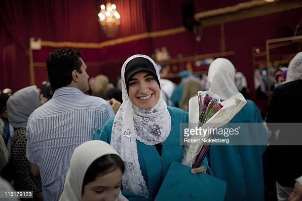 High school senior Asmaa Rimawi, 17 years, smiles after receiving her diploma after her high school graduation ceremonies from the al Noor School...