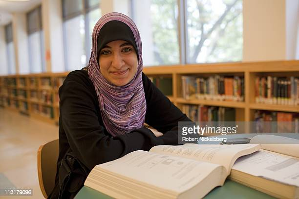 High school senior Asmaa Rimawi, 17 years, studies for a mathematics final exam at a branch of the New York Public Library, June 15, 2010 in...