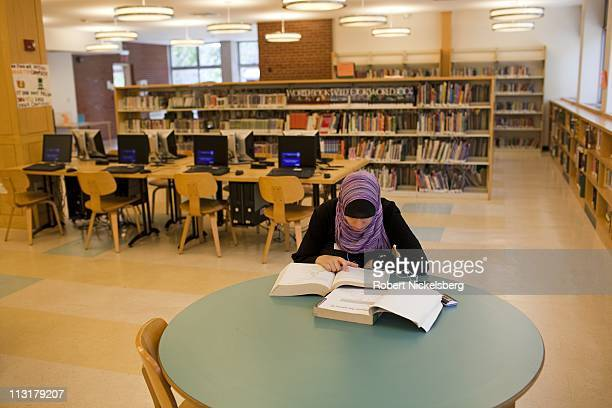 High school senior Asmaa Rimawi 17 years studies for a mathematics final exam at a branch of the New York Public Library June 15 2010 in Brooklyn New...