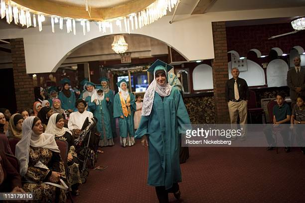 High school senior Asmaa Rimawi 17 years wears a traditional cap and gown during her high school graduation ceremonies from the al Noor School June...