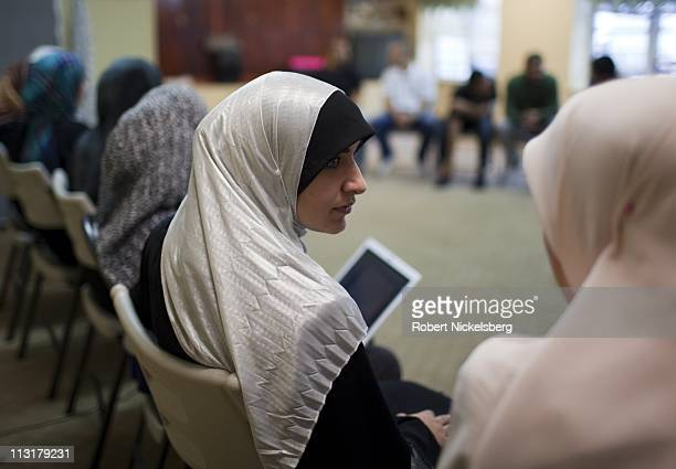 High school senior Asmaa Rimawi center attends a meeting at the Islamic Center of Bay Ridge Mosque June 12 2010 in Brooklyn New York Asmaa will...