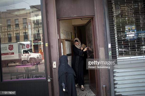 High school senior Asmaa Rimawi, right, greets an Arab-American woman at her apartment door June 12, 2010 in Brooklyn, New York. Asmaa will graduate...