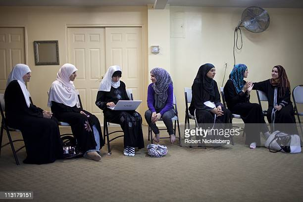 High school senior Asmaa Rimawi third left attends a meeting at the Islamic Center of Bay Ridge Mosque June 12 2010 in Brooklyn New York Asmaa will...