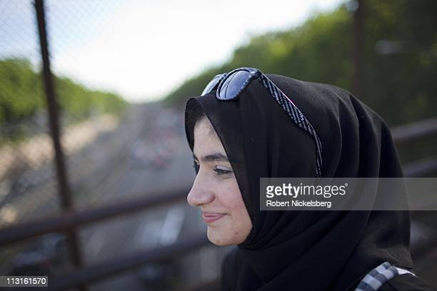 High school senior Dania Darwish, 17 years, walks to school, June 11, 2010 in the Fort Hamilton neighborhood of Brooklyn, New York. Dania will...
