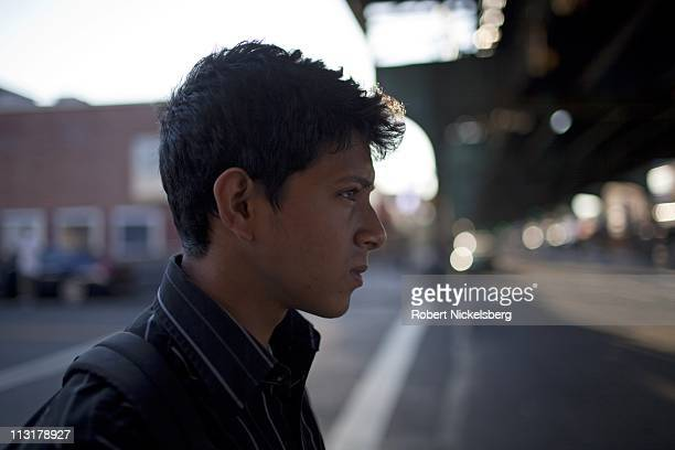 High school senior Mohamed Amin, 18 years, stands below a subway track on his way to school June 7, 2010 in Queens, New York. Mohamed will graduate...