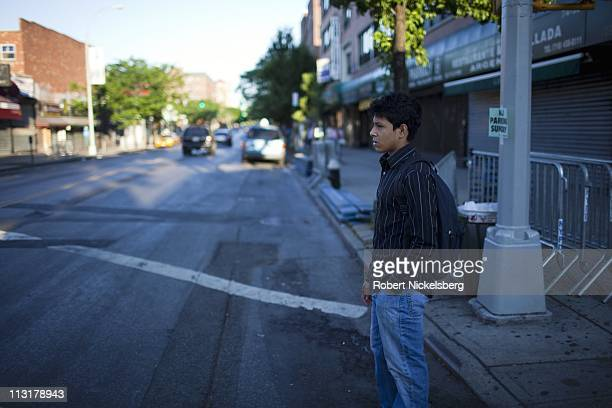 High school senior Mohamed Amin, 18 years, stands on a street corner on his way to school June 7, 2010 in Queens, New York. Mohamed will graduate...