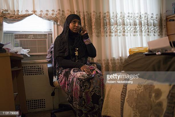 High school senior Sharmin Hossain, 17 years, speaks on her cell phone before leaving for her senior prom June 3, 2010 in Queens, New York. Sharmin...