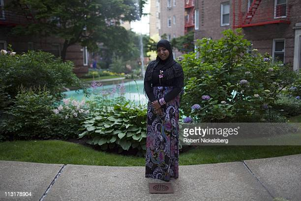 High school senior Sharmin Hossain, 17 years, stands for a photograph before leaving for her senior prom June 3, 2010 in Queens, New York. Sharmin...