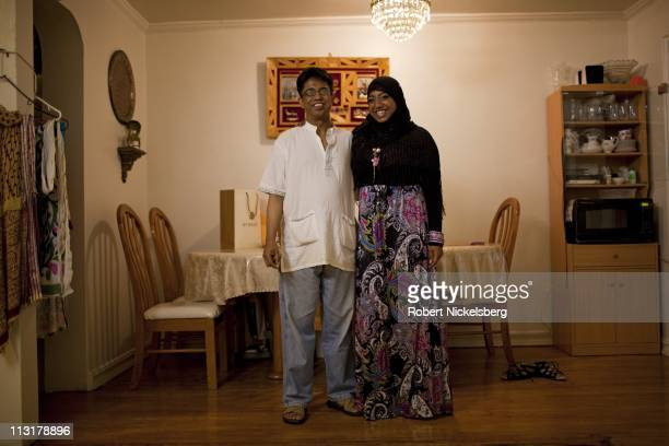 High school senior Sharmin Hossain, 17 years, stands next to her father, Mohamed, before leaving for her senior prom June 3, 2010 in Queens, New...