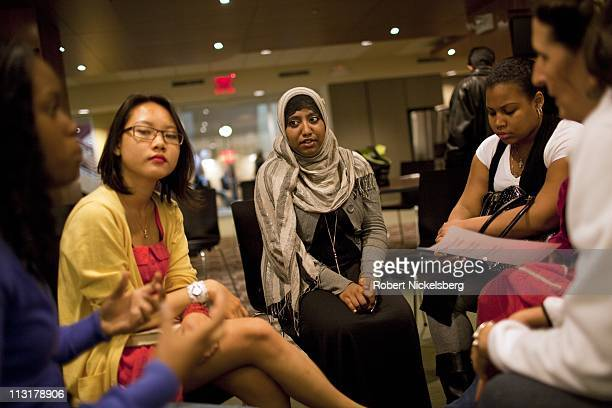 High school senior Sharmin Hossain center and her student colleagues plan ways to call on New York's Mayor Bloomberg to maintain the student...