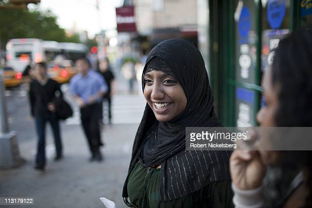 High school senior Sharmin Hossain, center, tries to recruit passersby to attend an open seminar May 15, 2010 sponsored by Youth Activists - Youth...