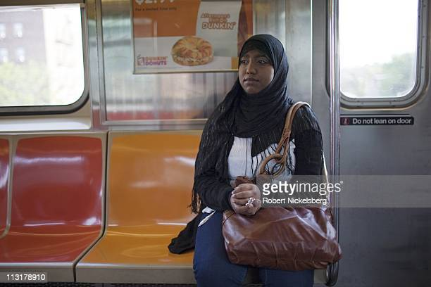 High school senior Sharmin Hossain rides the subway May 11 2010 on her way to school in Queens NY She will spend 90 minutes traveling each way to...