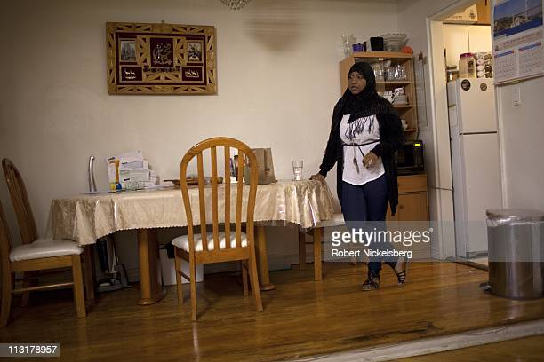 High school senior Sharmin Hossain stands in her family's apartment May 11, 2010 before leaving for school in Jackson Heights, NY. She will spend 90...