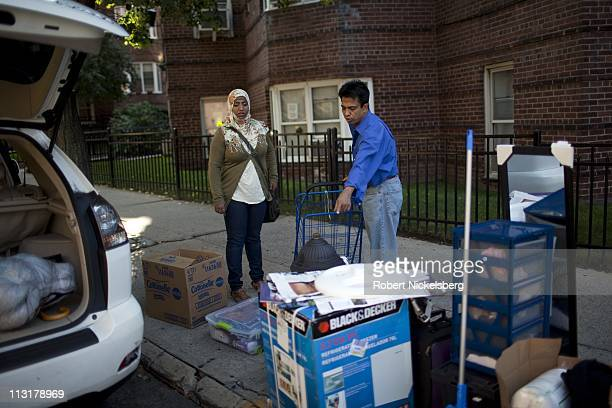 High school senior Sharmin Hossein, 18 years, speaks with her father, Mohammed, about packing her luggage August 26, 2010 in Jackson Heights, New...