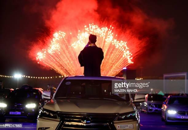 High school seniors of Bahrain Bayan School and their families watch fireworks at Bahrain International Circuit in Sakhir race track on June 10, 2020...