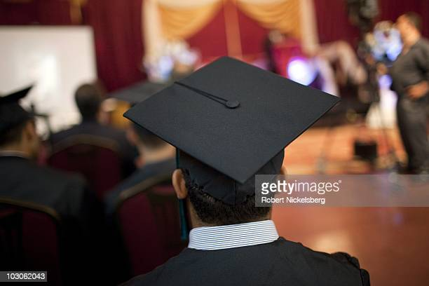 High school seniors wear a traditional cap and gown while attending their high school graduation ceremonies from the al Noor School June 23 2010 in...