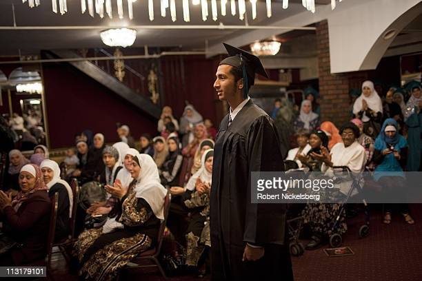 High school seniors wearing a traditional cap and gown attend their high school graduation ceremonies from the al Noor School June 23 2010 in...