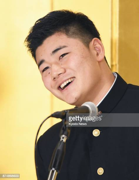 High school slugger Kotaro Kiyomiya the most soughtafter player in October's amateur draft speaks at a news conference in Tokyo on Nov 16 after...