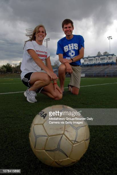 High school soccer player of the year Skyline's Nikki Marshall left poses with soccer coach of the year Broomfield's Jim Davidson at Elizabeth...