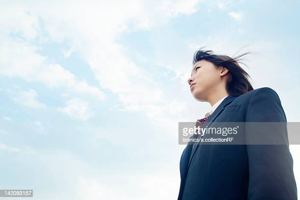 high school student against blue sky - 制服 ストックフォトと画像
