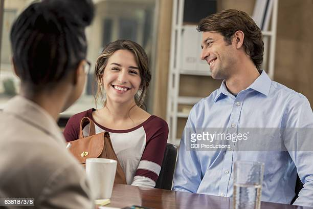 High school student and her father talk with guidance counselor