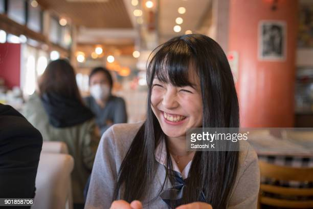 high school student girl smiling in cafe - female high school student stock pictures, royalty-free photos & images