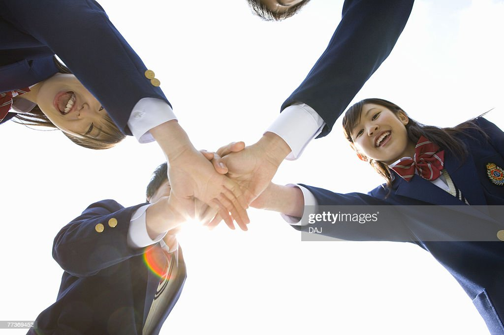 High School Student in Huddle with hands together : Photo