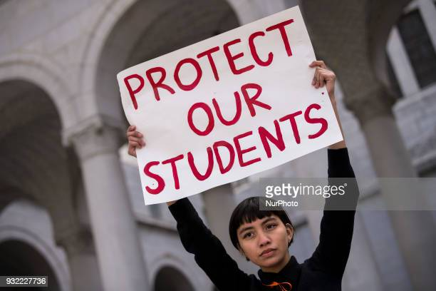 High school student Sofia Ramirez participates in a protest against gun violence Los Angeles California on March 14 2018 Students across the US...